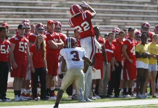 Cornell's Shane Savage jumps up for a ball in a game against Harvard at Schoellkopf Field Oct. 8. Despite the 41-31 loss to the Crimson, Savage had 8 receptions for 152 yards and two touchdowns. (Photo by Tim McKinney).