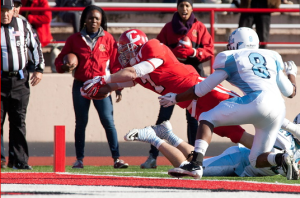 Big Red Shootout–Cornell receiver Grant Gellatly dives into the endzone for a touchdown in the first quarter in a game against Columbia Saturday afternoon at Schoellkopf Field. The Big Red's 62-41 victory over Columbia was its highest point total since 1936. (Photo by Patrick Shanahan)